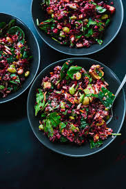 raw beet salad with carrot quinoa spinach in bowls