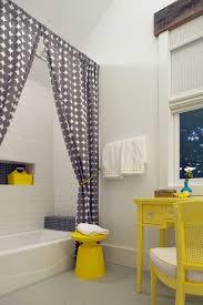 beach style bathroom by rethink design studio