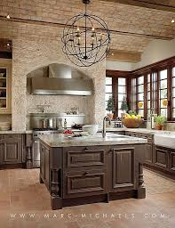 Beautiful Mediterranean kitchen ~ Love all the brick and stone work. Nice  chandelier. b