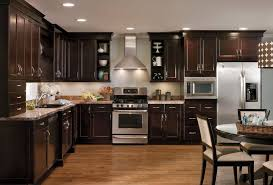 cherry kitchen cabinets with granite countertops white granite kitchen countertops killim area rug spindle counterstools brown
