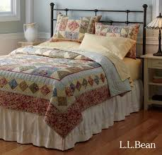 l l bean s lakehouse bed and handstitched fl quilt lend a charming vintage look to any room