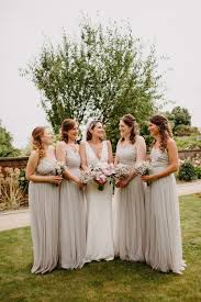 bridal party bridesmaids in taupe dresses with tulle embellished bodices bride in halo