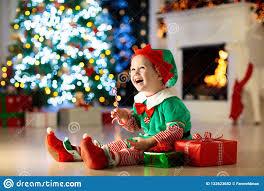 Christmas Photo Kids Kids At Christmas Tree Children Open Presents Stock Photo