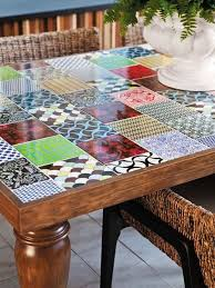 old table with patchwork tile tabletop, would be a cool patio table
