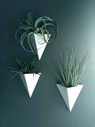 white ceramic wall planter pyramid hanging vertical blue and hexago