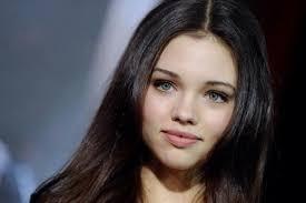 india eisley fai skin dark brown hair and pale green eyes