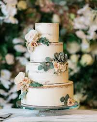 Four Tier Wedding Cake With Earth Tone Sugar Flowers Greenery