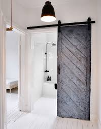 ... Reused Old Barn Door Creates A Fabulous Entrance For The Scandinavian  Bathroom [Design: MR Decoist