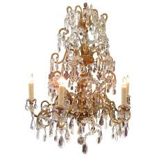 18th century italian genoese chandelier with finely carved giltwood and crystal for