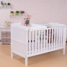 white wooden baby cots
