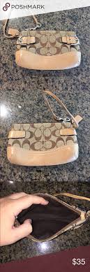 Coach fabric wristlet Tan Coach monogram wristlet with buckles. Great  condition. Brown interior fabric. Coach Bags Clutches   Wristlets