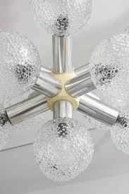 this mid century modern chandelier was made in the 1960s in germany it is
