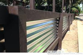 installing corrugated metal creating a modern wood metal retaining wall fence how to install corrugated metal wainscoting exterior installing corrugated