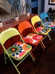 old metal folding chairs made new again spray paint and new fabric
