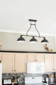 updating overhead kitchen lighting to these beautiful black farmhouse pendant lights from jeremiah lighting