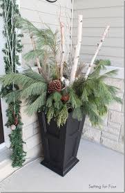 from 5th and state this winter garden planter is a perfect example of using both living plants and branches this one includes white ornamental cabbage