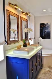 master bathroom had been updated with a custom designed royal blue vanity individual mirrors with picture lights semi recessed rectangular sinks