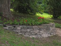 if you have a tree that grows on a hillside and wish to make a garden beneath its leafy canopy do consider building a demi lune wall at the tree s base