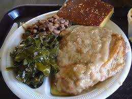 The Neeleys Smothered Pork Chops Recipe  Genius KitchenCountry Style Smothered Pork Chops