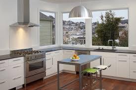 zephyr hoods kitchen modern with breakfast bar caesarstone corner windows dark wood