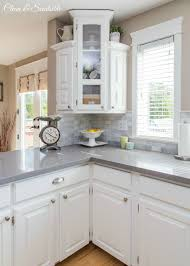 beautiful white kitchen with grey quartz countertops