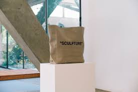 neutral sculpture canvas tote bag viscose leather linen flax virgil abloh for off white canvas tote with printed text spring summer 2018