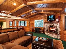 rustic style living room design with l shape brown leather sofa and corner stone fireplace also oak wooden wall decor