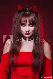 y woman in a devil costume a demon with horns in a red dress american dress for a costume party choker on the neck bright makeup