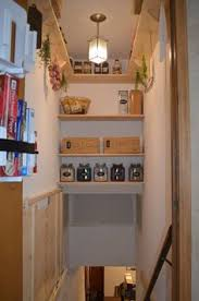 Stairwell pantry! Such a clever use of this unused space.