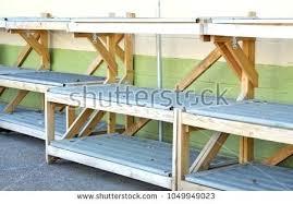 painted cinder block shelves empty outdoor market display shelves against painted cinder block wall awaiting gardening