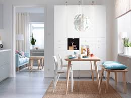 dining table combined light blue chairs a bright dining room with an ash table that seats four people combined