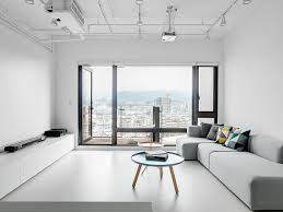 White interior with pastel coffee table White apartment with a city view
