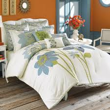 create a fresh and modern look in your bedroom with this cheery bedding shades of blue and green on crisp white are the base of the large scale fl
