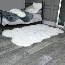 white faux rug large four pelt white faux fur rug x black and white faux cowhide