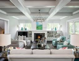 gray coffered ceiling with classic ring chandelier