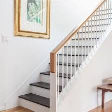 Modern Stairs Feature Metal & White Oak Railing