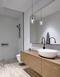 modern bathrooms. A Patterned Floor, Wooden Vanity, Black Touches That Make The Neutral  Space More Modern Bathrooms