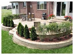 Backyard Concrete Designs Extraordinary Stamped Concrete Patios ELEVATED PATIO WITH RETAINING WALLS