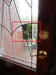 there are 3 broken panes in this door panel 2 glue chip and 1 water glass after the repair