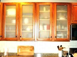 putting glass in cabinet doors door adding to kitchen cabinets diy sliding putt