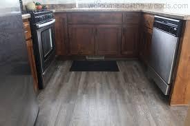 weathered gray diy luxury vinyl plank flooring installation