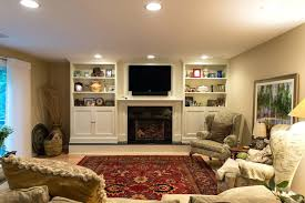 fireplace tv wall unit wall units stone fireplace custom bedding natural master bedroom bedroom style masculine