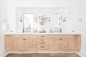 light stained oak dual washstands with white upper cabinets
