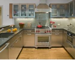 Inspiration for a contemporary u-shaped kitchen remodel in New York with subway  tile backsplash