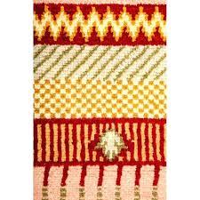 orange area rug hnd ornge re with white swirls 4x6 5x8
