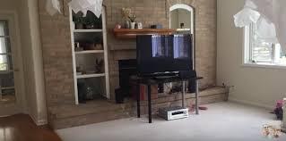 tv hole above fireplace