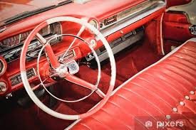 classic car interior with red leather upholstery vinyl wall mural on the road
