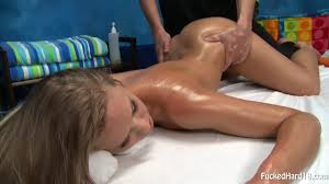 Naked blonde with beautifully trimmed pussy on massage table.