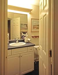 image top vanity lighting. Adorable Modern Bathroom Lighting With Wall Mounted Lamp Above The Mirror Added White Wooden Cabinets Image Top Vanity