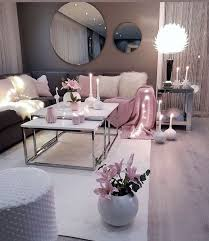 living room setup grey pink and white